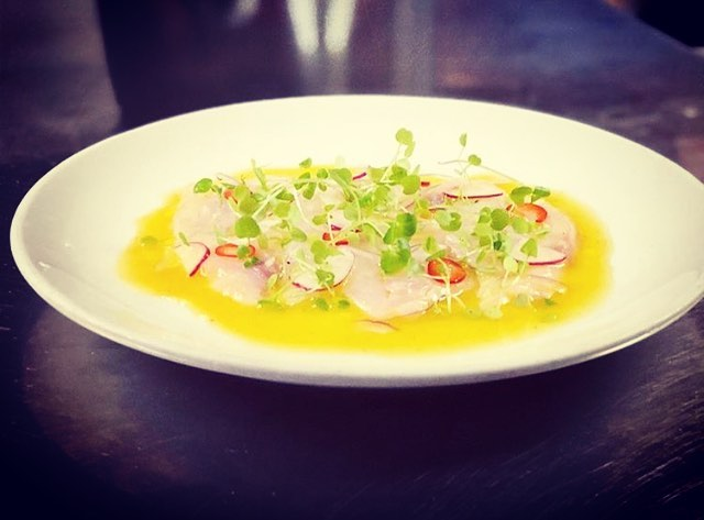#saturdaynight #eeeeeeats .... Branzino #crudo with #passionfruit vinaigrette #repost of #chefpics @josemunoznyc #burgerandbarrel #bnbwinepub