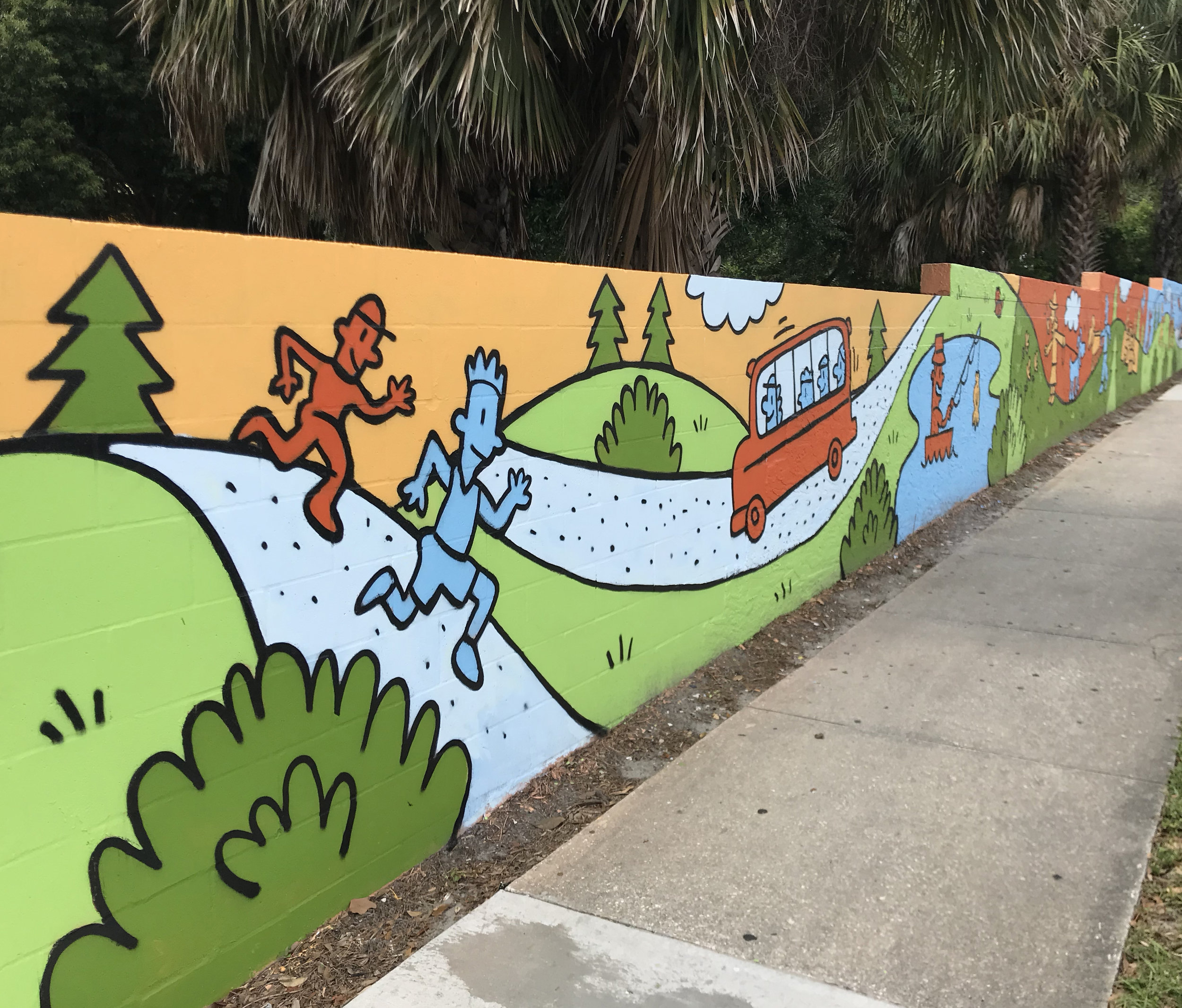 In March 2019,  United Cerebral Palsy (UCP) of Central Florida Charter School  asked me to design a mural for a 6 ' x 200 ' wall at their Pine Hills Campus in Orlando, Florida. The painting was produced and overseen by  Joe Starkweather  and a group of over 60 friendly and helpful volunteers helped with the painting. The mural was completed on May 10, 2019.