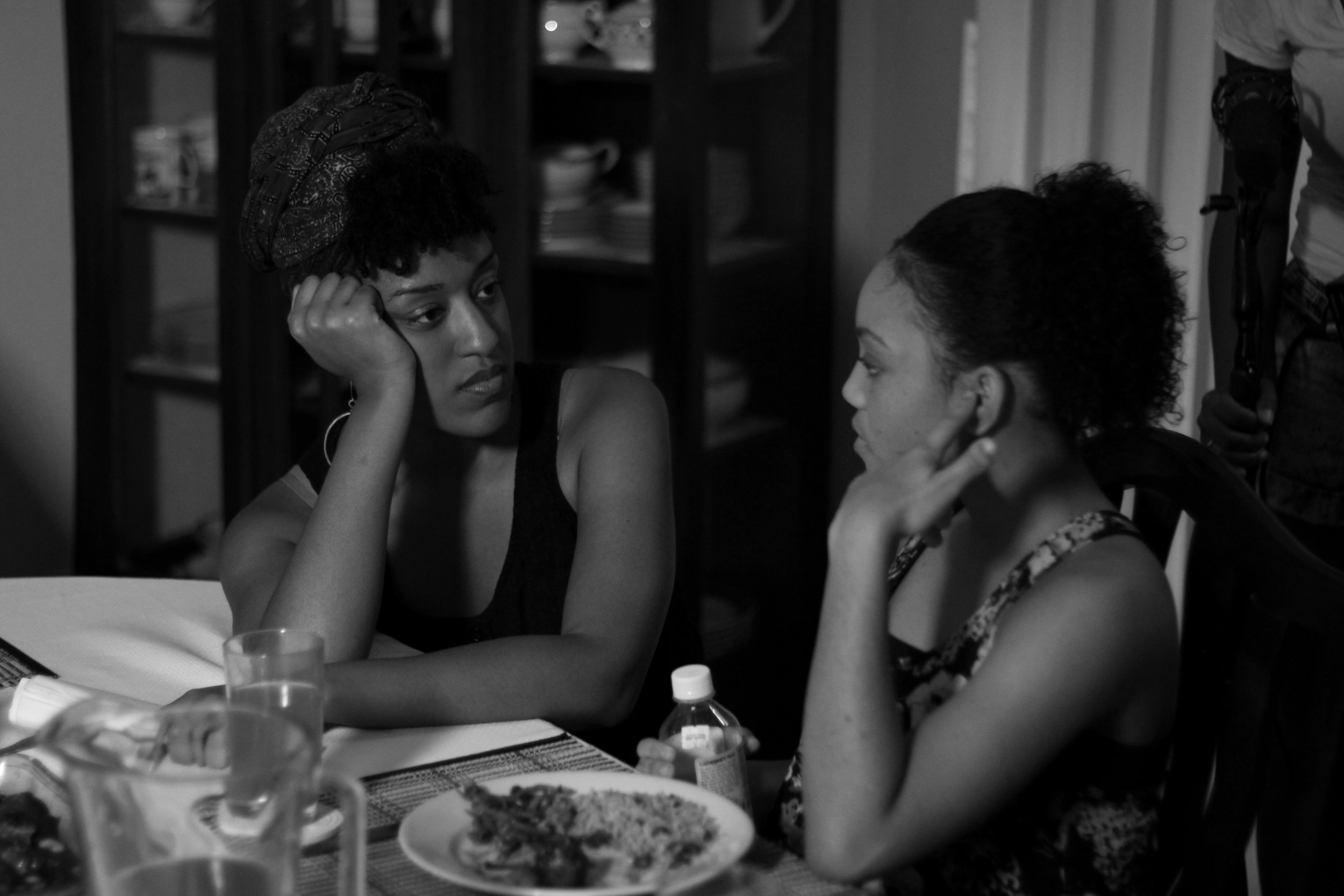 Sontenish and actress Jhada Ann Walker while shooting the dinner scene.
