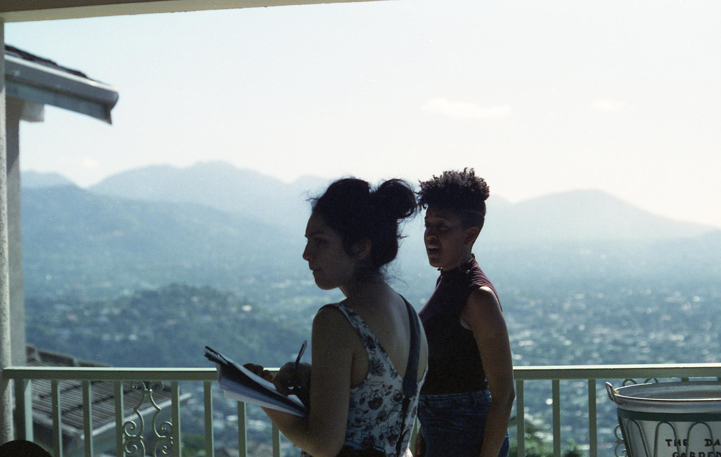Sontenish and Cinematographer Zamarin Wahdat planning the shots for the balcony scene.