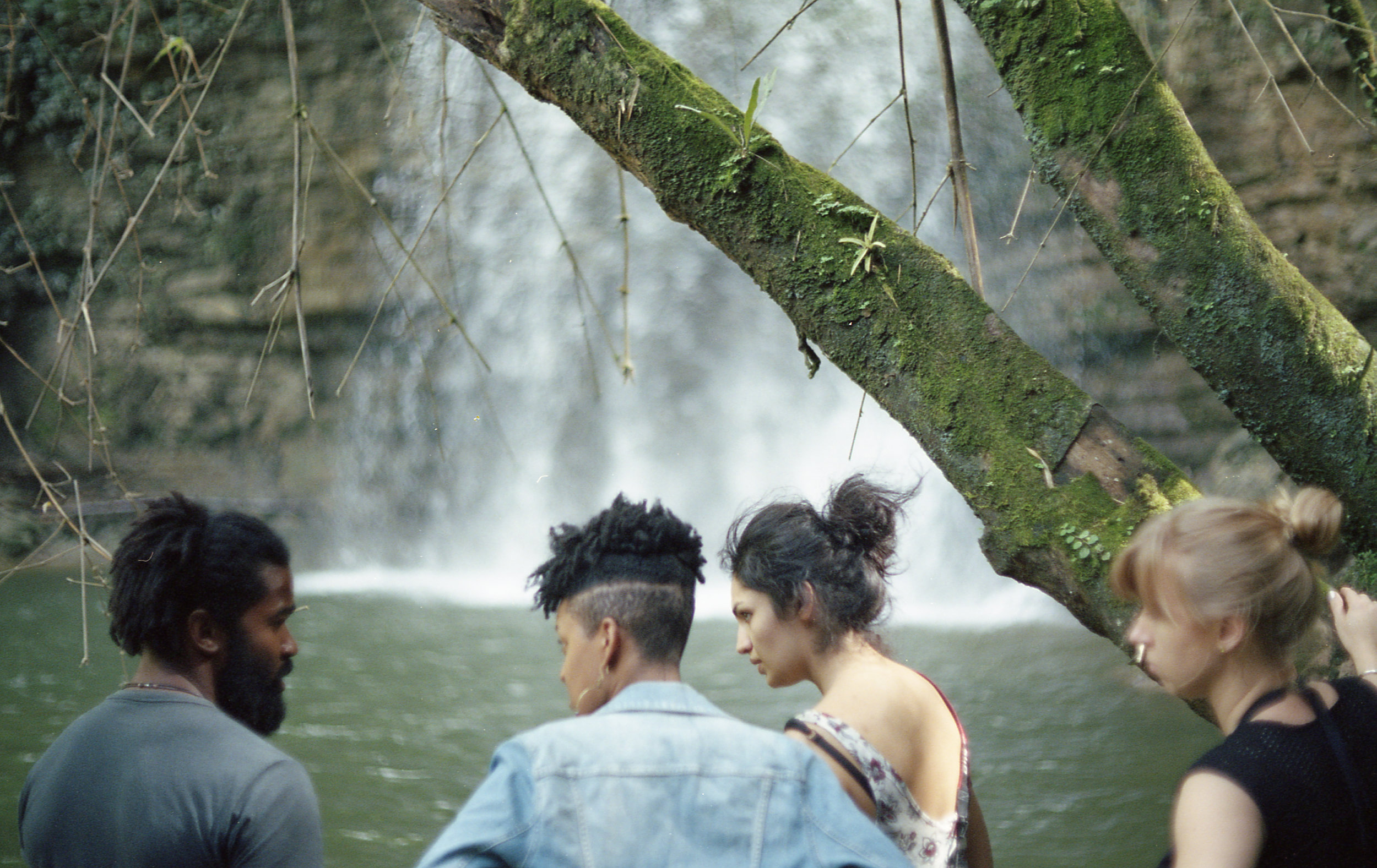 Brian Moore (Additional AD), Sontenish (Director), Zamarin Wahdat (DP), and Dominica Eriksen (AC) during location scout at the waterfall.