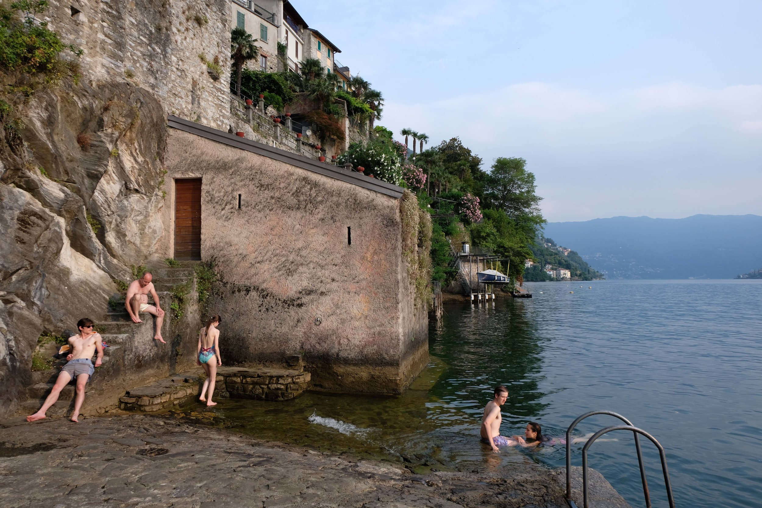 Bathers in Nesso, on Lake Como, Italy. Photograph by Zander Abranowicz.