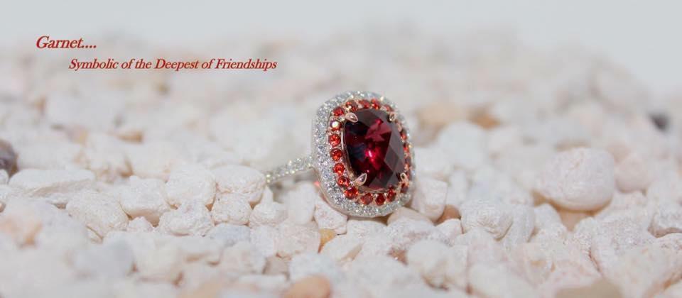 Garnet, diamonds custom ring.jpg