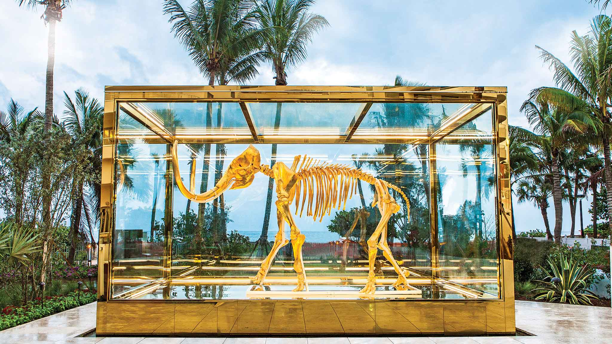 """Faena, Miami   Alan Faena proclaimed,""""It is the future. A unique utopian city for the mind that thinks in 360 degrees"""". He wasn't wrong. Featuring an almighty Damien Hirst gilded woolly mammoth skeleton, Faena's cube-like white artifice is topped with a glazed eye set into its domed ceiling.With plenty of flair from the eccentric director, Baz Luhrmann, and costume designer, Catherine Martin, a stay at the Faena is akin to stepping into a film set. Think outlandish lashings of colour with Juan Gatti's exotic murals adorning the walls – every detail is dramatically pronounced. faena.com"""