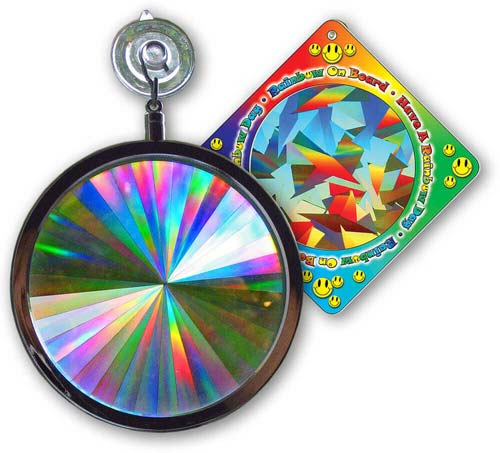 """Axicon Rainbow Window Sun Catcher  Your Axicon Rainbow Window Sun Catcher™ state-of-the-art Holographic Prism starts with laser technology and ends with pure spectral color. Hanging from a window in DIRECT SUNLIGHT, your Axicon Rainbow Window Sun Catcher will transform the sunlight light into an explosion of multiple hues. 4"""" Diameter, laminated glass prism mounted in a silver finished chrome frame. Comes with a vinyl rubber suction cup for easy hanging.Includes a""""Rainbow on Board"""" Sun Catcher...Free!    Shop Here"""