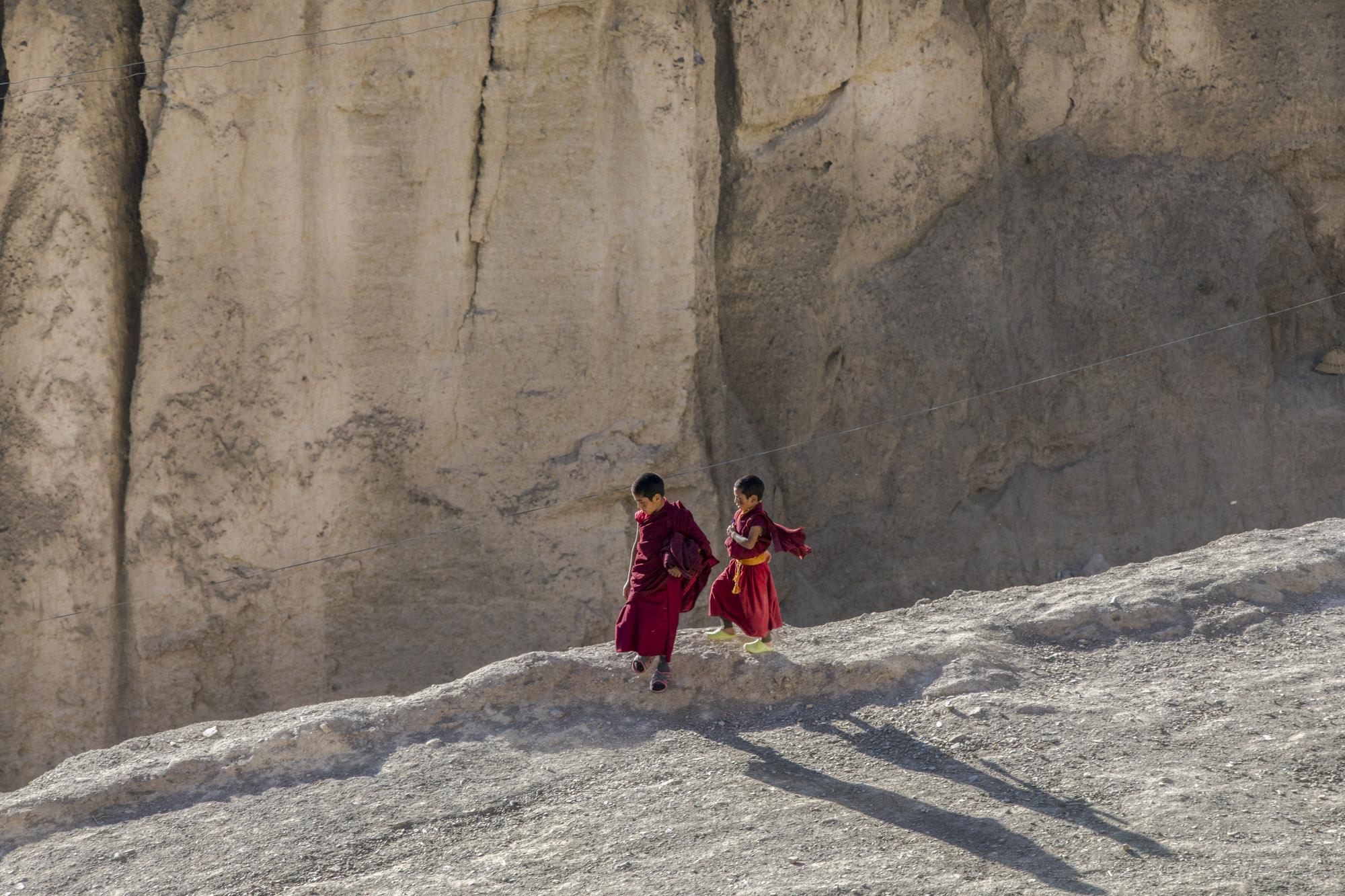 Young Tibetan monks head to prayer. Lamayuru, Ladakh. India