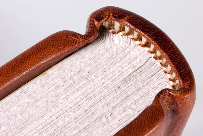 Hand sewn end-band, leather head cap & deckled pages