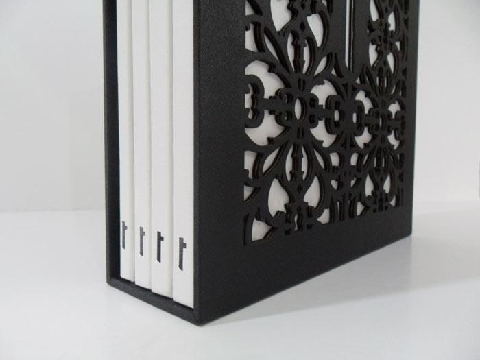 Black gloss foil (spines) & laser cut slipcase