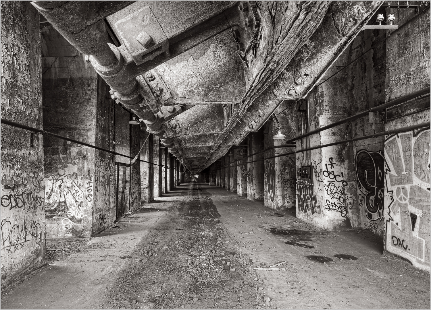 The Stock House at the Carrie Furnace. The dark area on the ground is where train tracks ran, to allow 'Larry Cars' to receive tons of raw materials from the overhead hoppers.