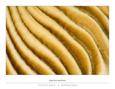 An abstract photograph of stone that looks like sand dunes seen from above