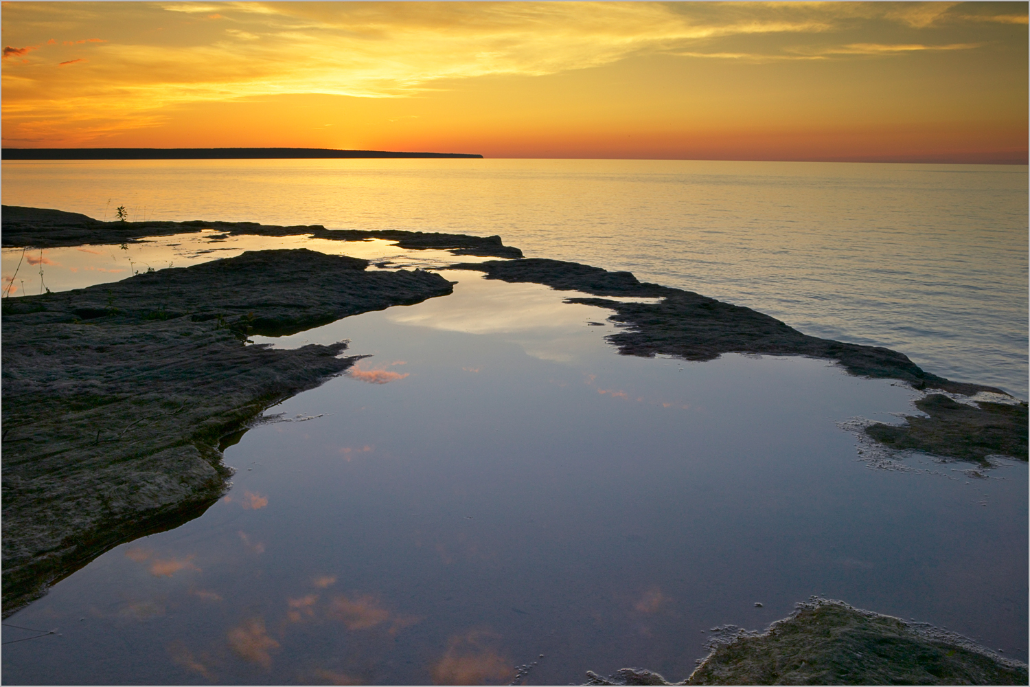 Lake Superior shoreline at sunset in Michigan's Upper Peninsula