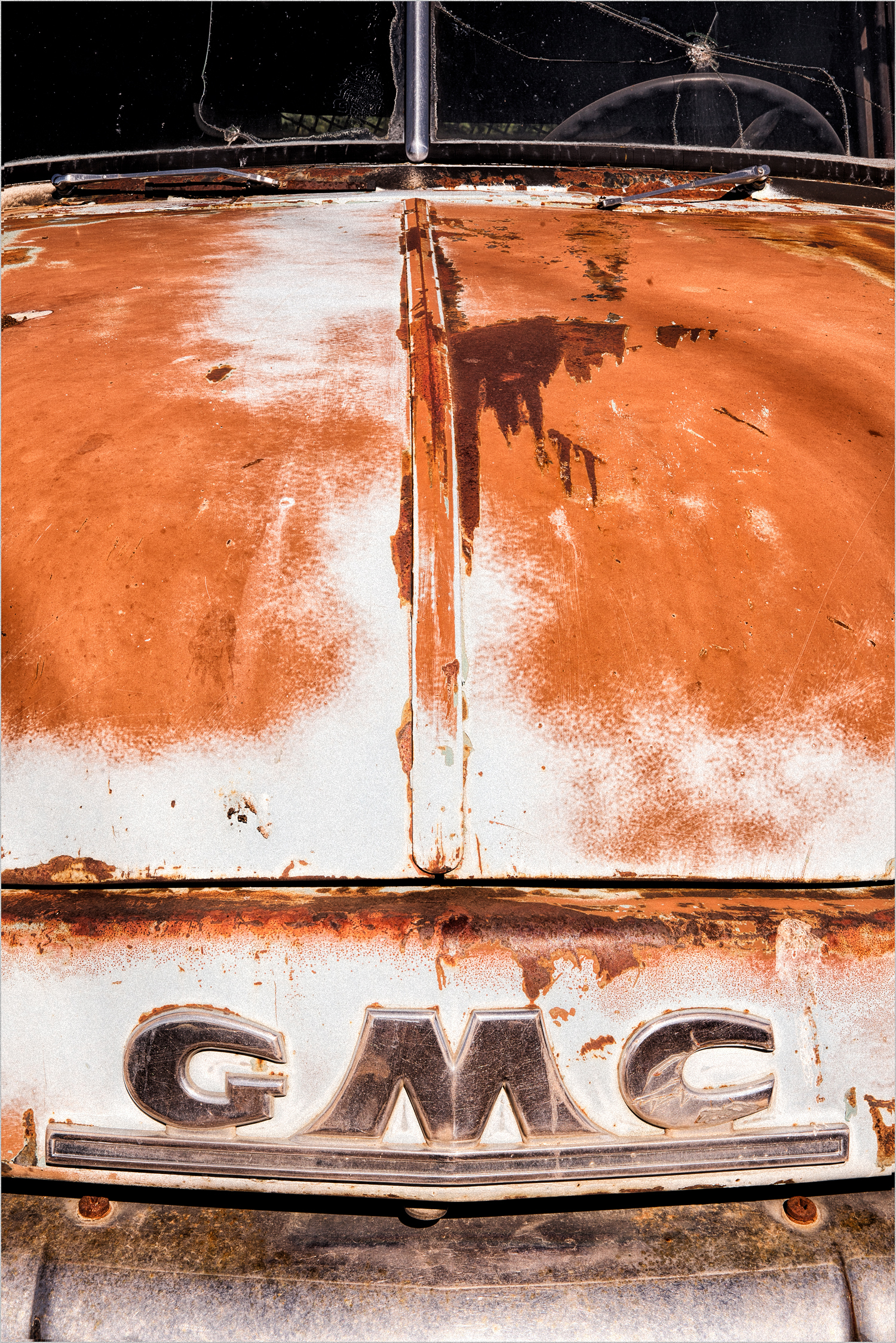 Old GMC truck in a truck graveyard in the Palouse  © Howard Grill