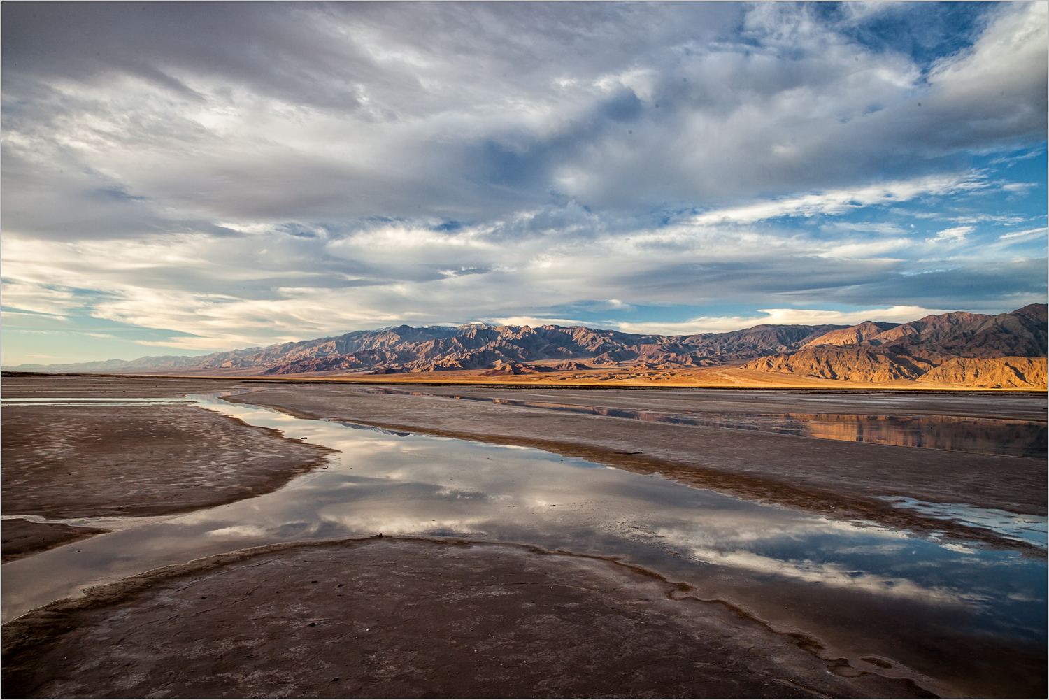 Rivulets on Death Valley salt flats after rain © Howard Grill