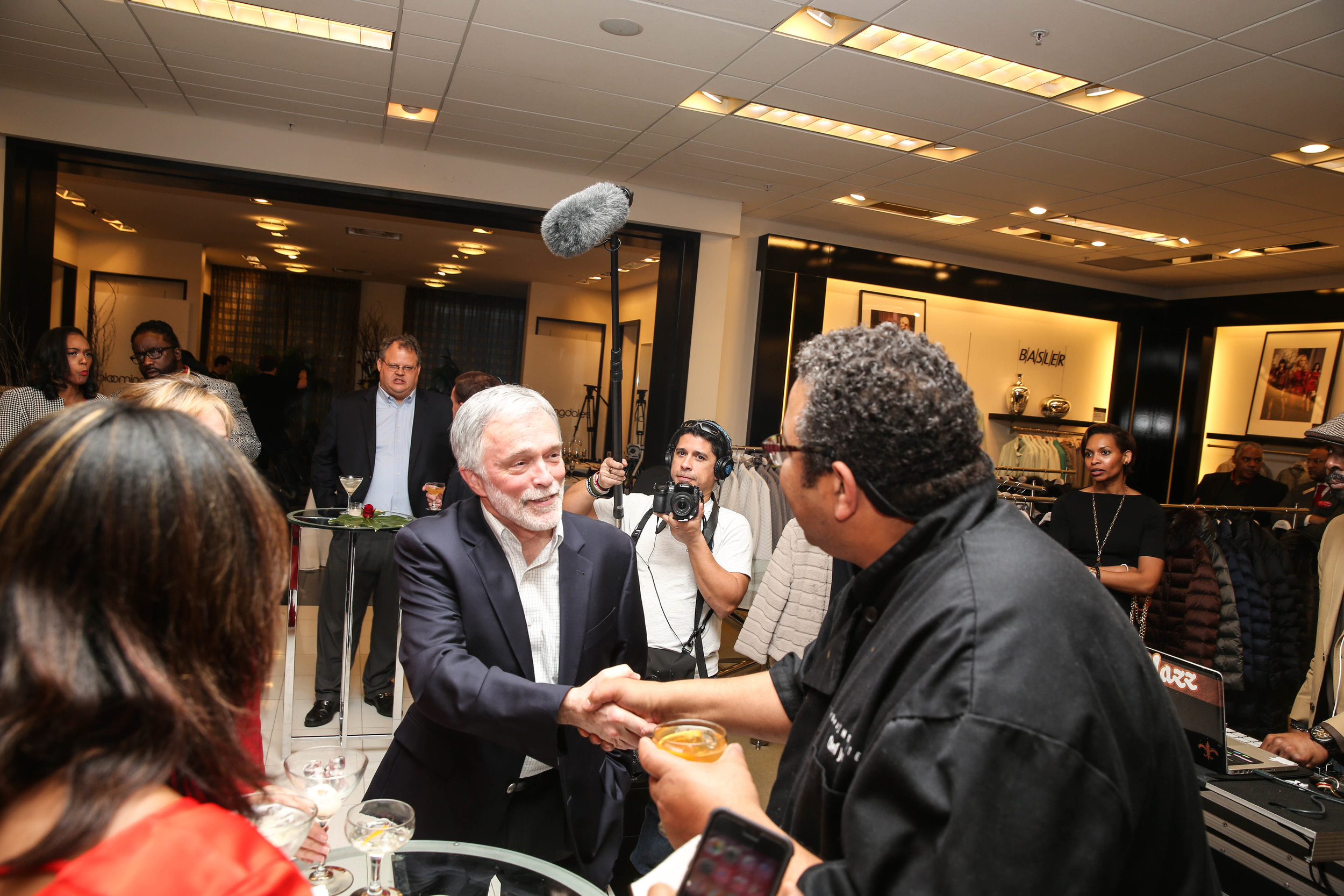 Juan Greeting Guests as Camera Roll