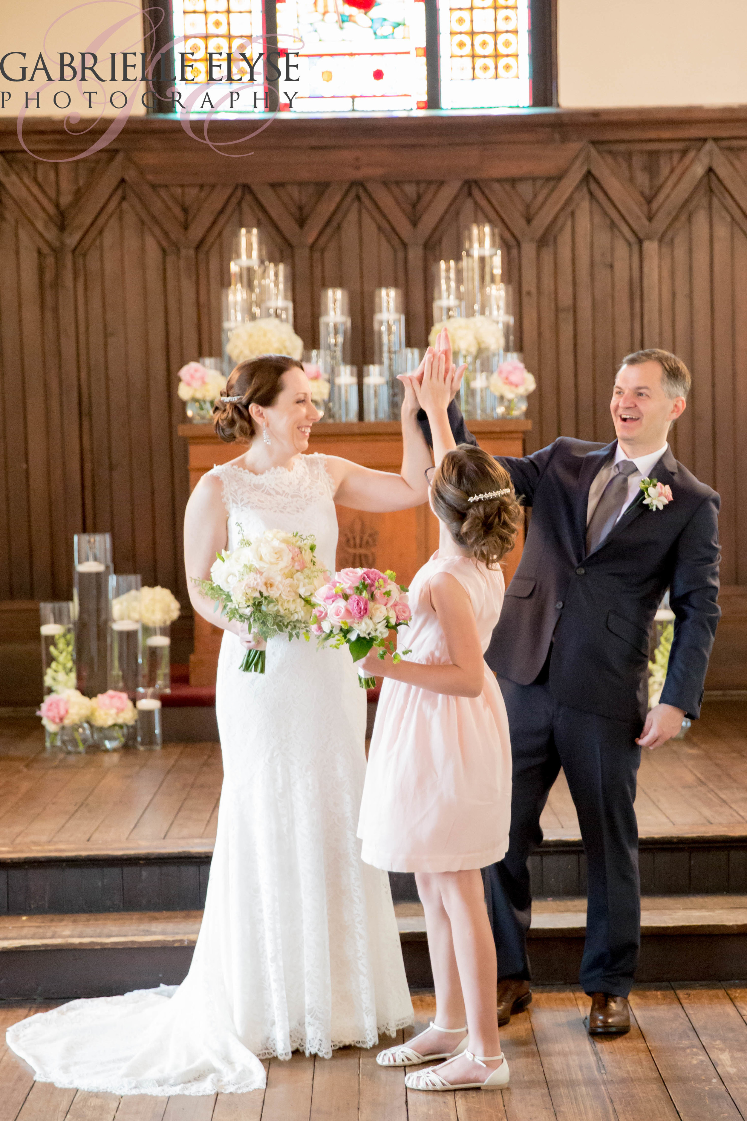 Love this family of three's post - ceremony High-Five! Perfect!