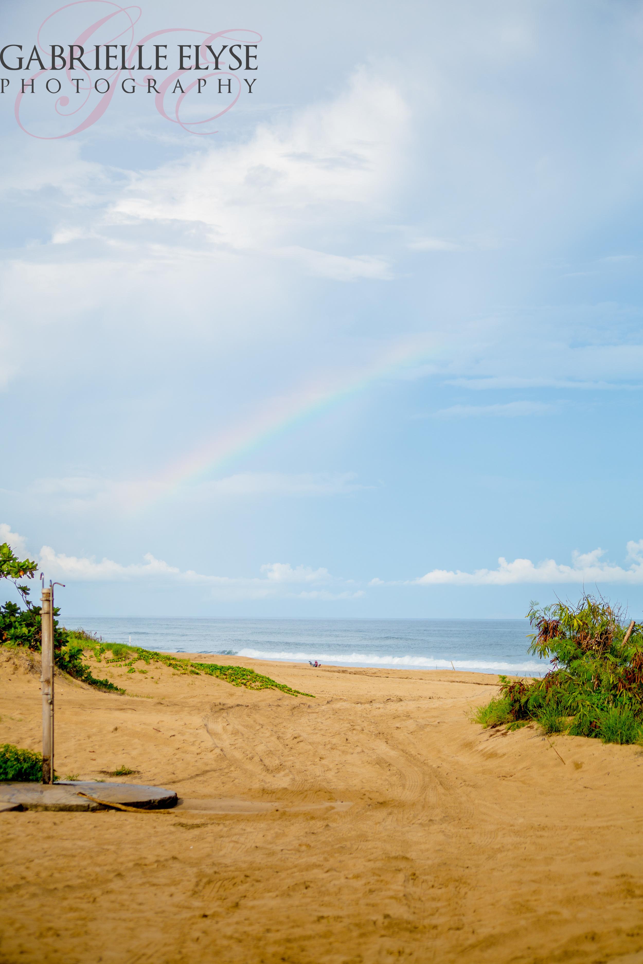 I mean really?! Beach, blue sky, and a rainbow.