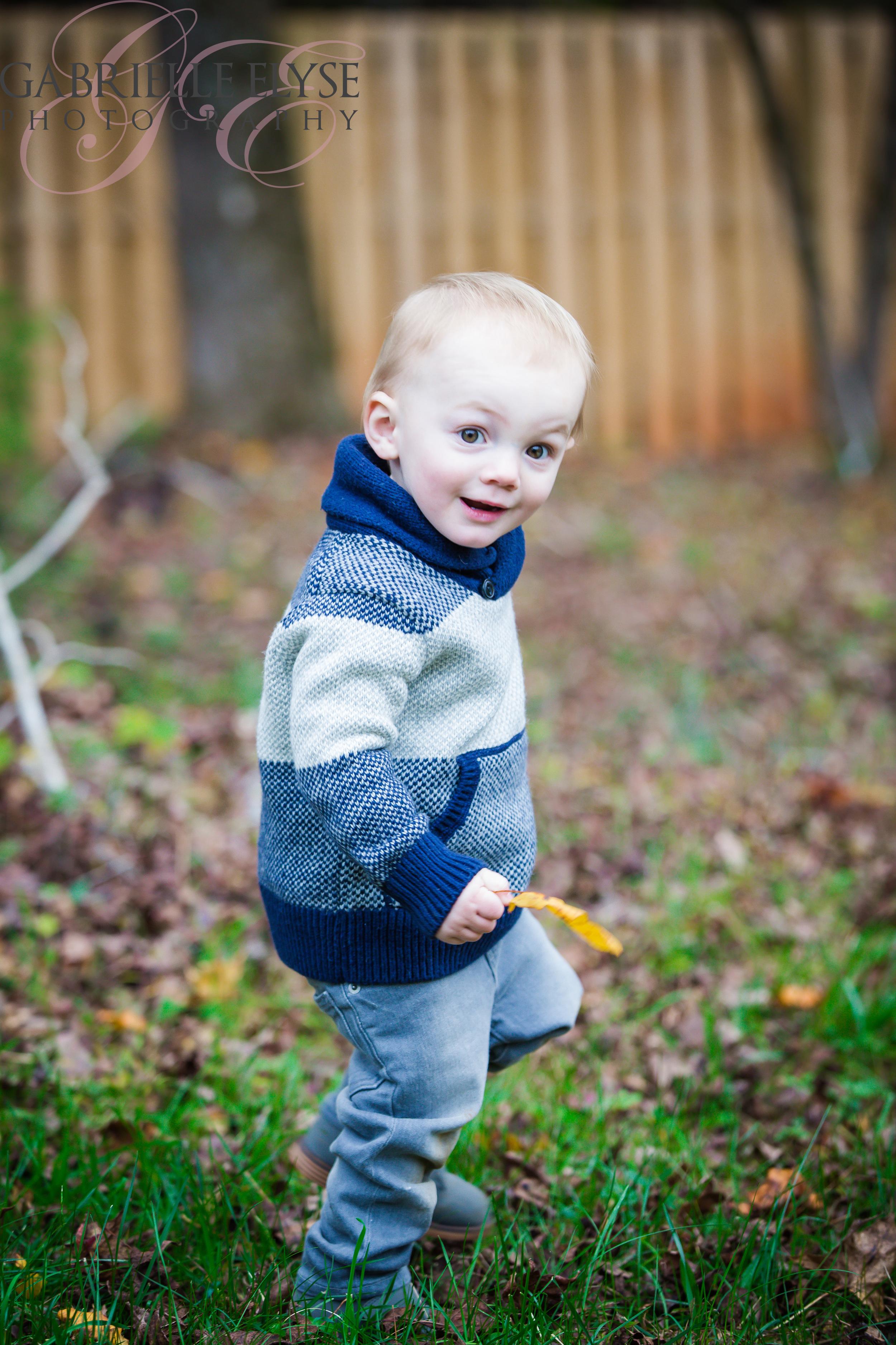 boy outside with leaf