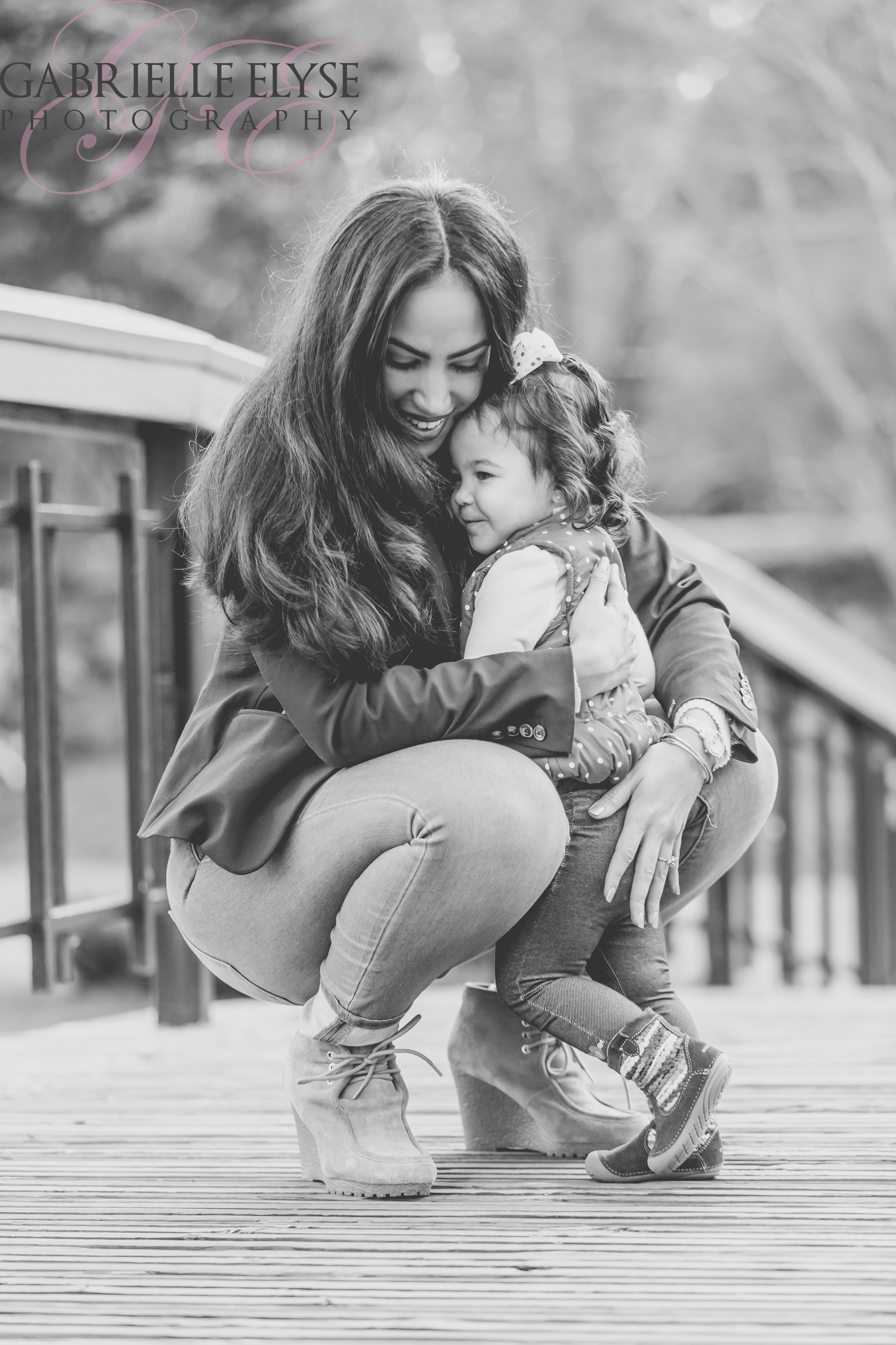 mommy daughter hug black and white