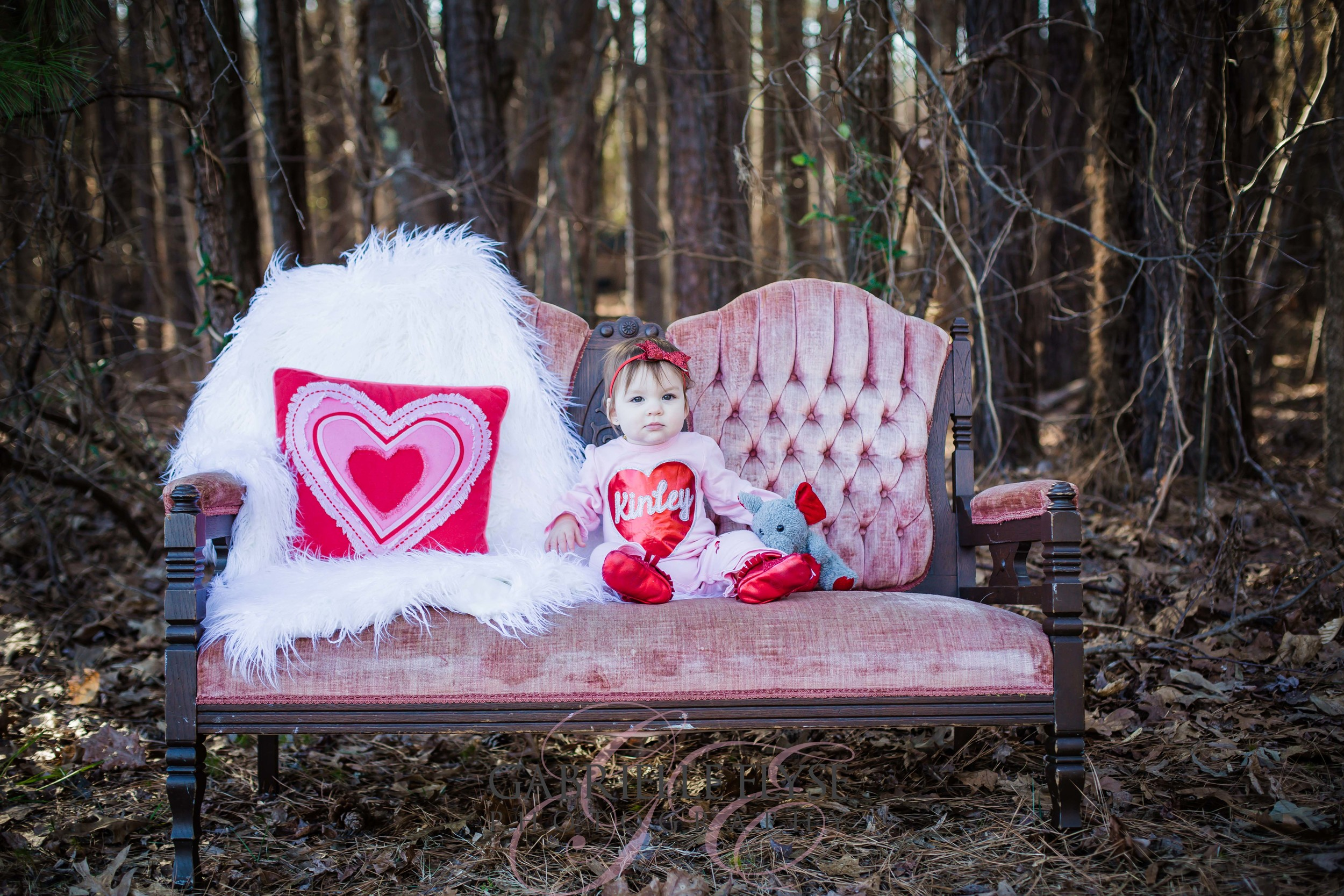 baby girl on couch hearts
