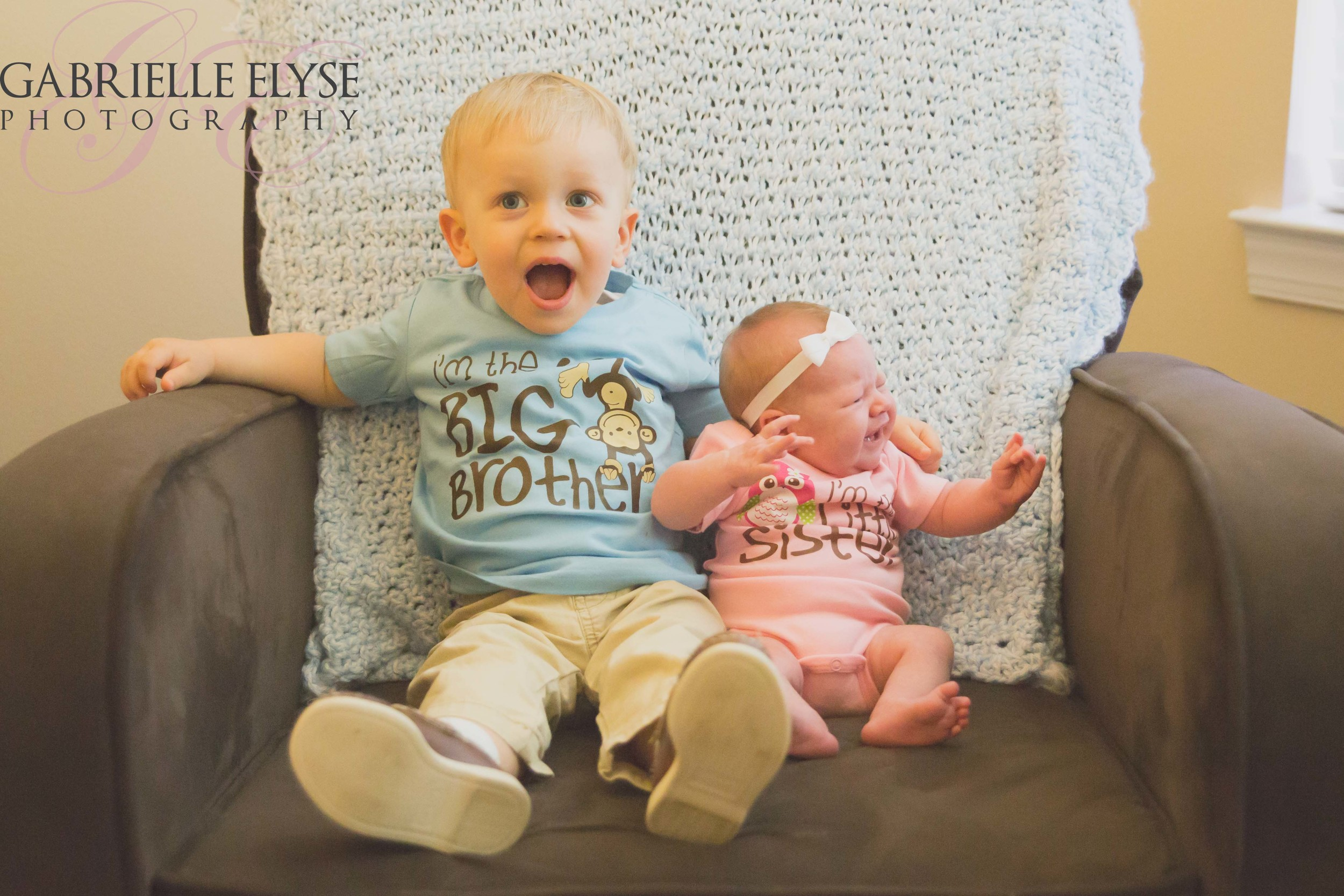I just love his expression! He is the big brother - no doubt about it :