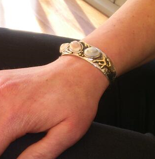 exclusive cuff bangle worn by client.