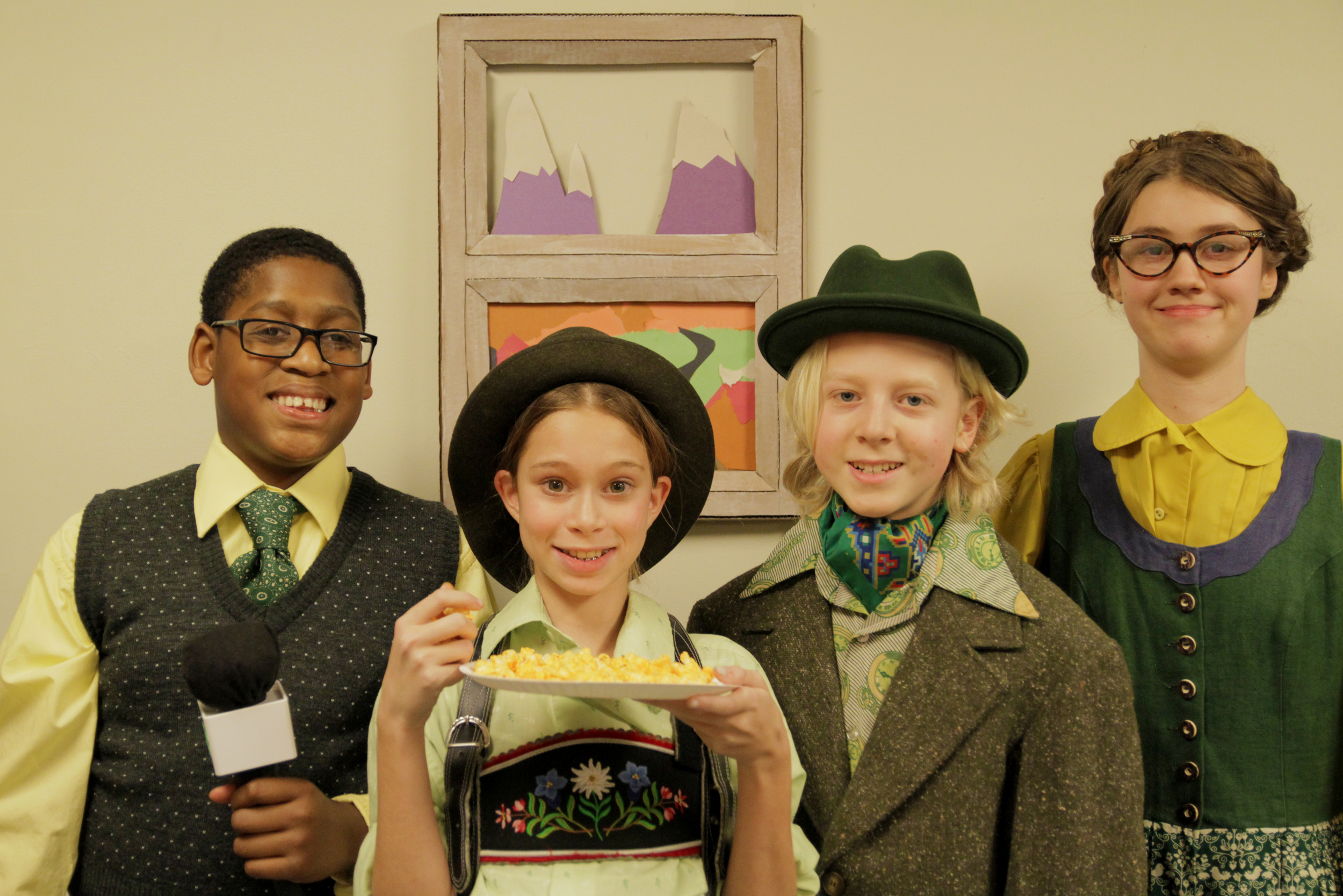 Still from newcast video shoot featuring Augustus Gloop and family.