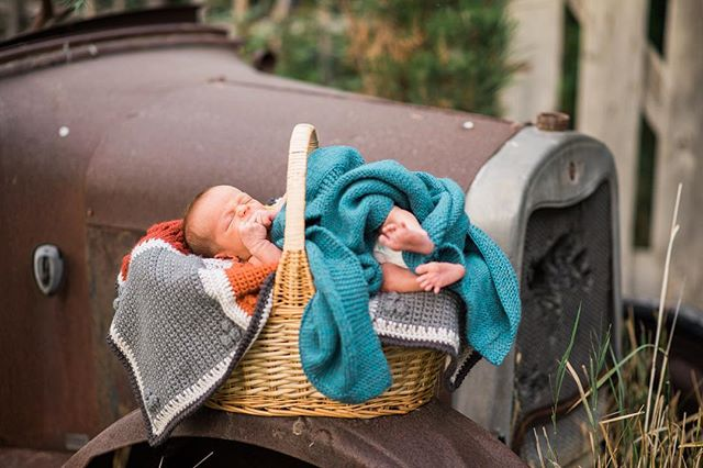 This kid has the manliest newborn photos ever. 🚗 📷