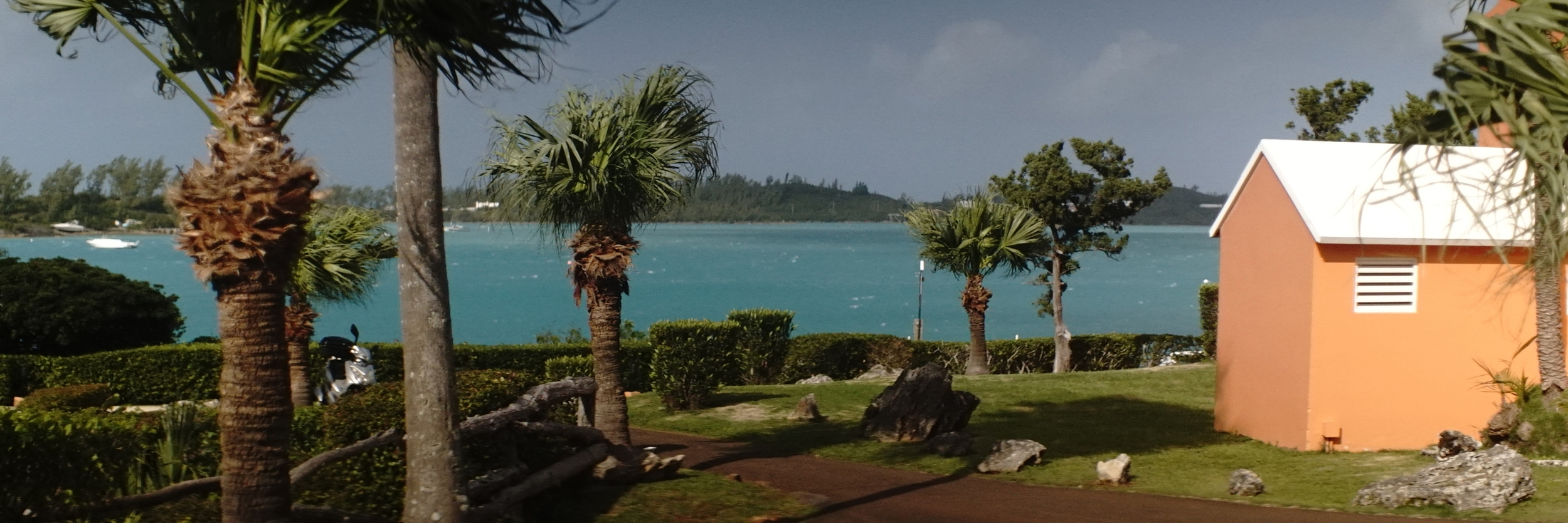 Grotto Bay Beach Resort - Bermuda. I am stopped down to an f5.6 here. You can see the tree in the frame left foreground is still out of focus, and I am probably a good twenty feet from it. | Lomo 50mm square front anamorphic | Keith Nickoson