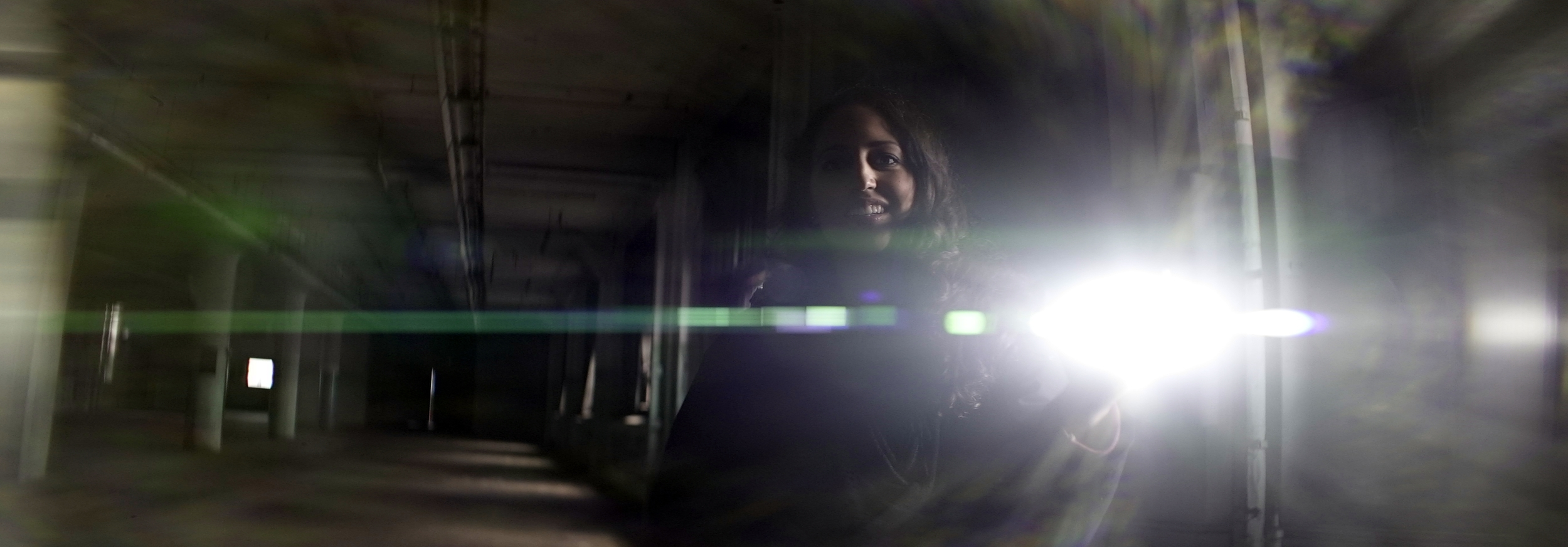 Elite 24.5mm anamorphic | Warehouse, Cleveland, OH - Lens flare triggered by Olivia Otten with the Nitecore P12 flashlight. Image captured wide open at T2.1. Image displayed full gate, 3.00:1. Photo by Keith Nickoson.