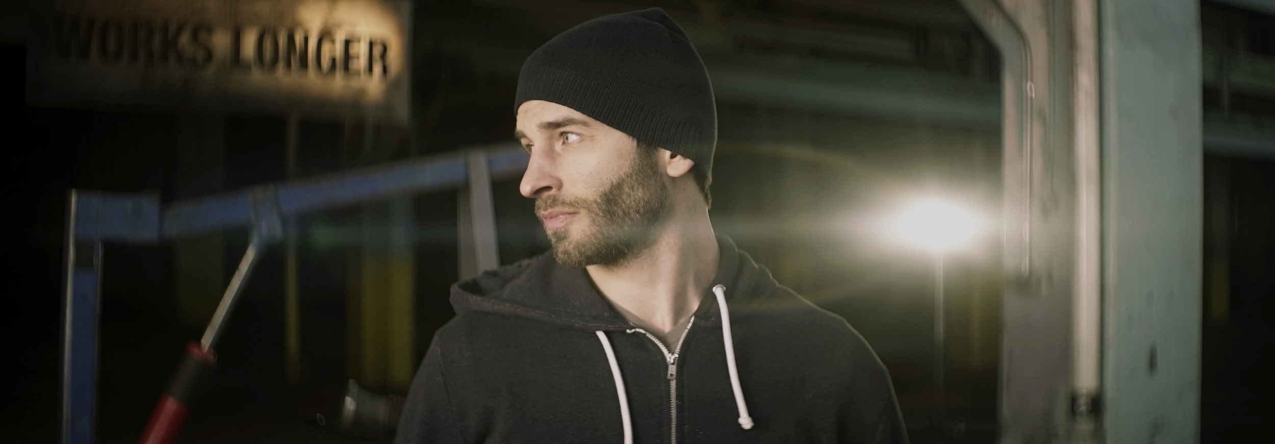 Lomo 50mm square-front anamorphic | Warehouse, Cleveland, OH. Fellow shooter and filmmaker William O'Boyle striking a pose here as a flare attacks his neck. Lighting instrument is a ETC Desire D40 daylight LED. Image captured wide open. Photo by Keith Nickoson.