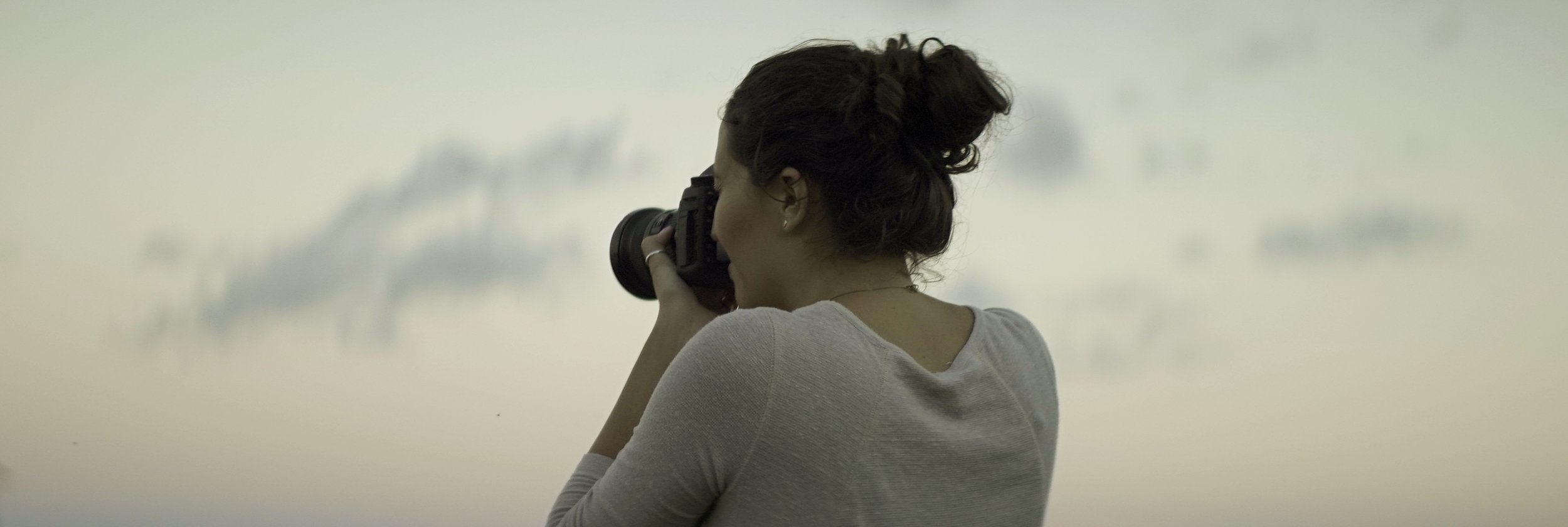 Lomo 100mm anamorphic lens | Olivia snapping a photo on the Canon 5D mark iii - Mackinac Island, MI - Photo by: Keith Nickoson