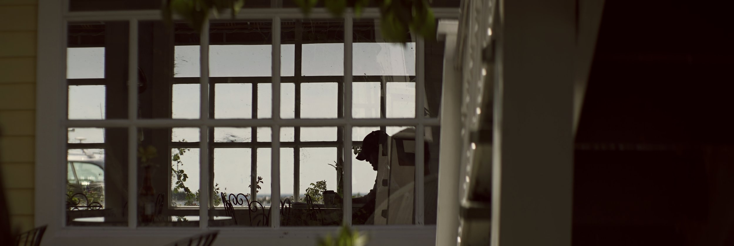 Lomo 100mm anamorphic lens | A coffee shop near the east bluff. Photo by: Keith Nickoson