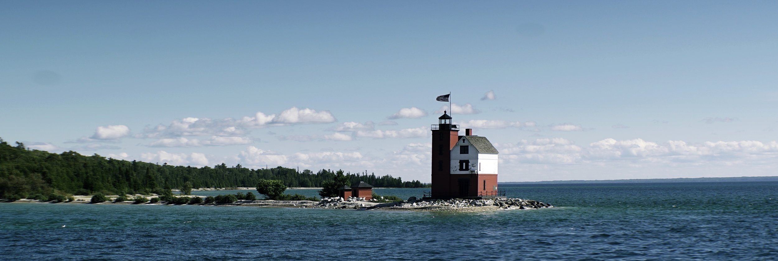 Lomo 100mm anamorphic lens | Round Island Lighthouse - Mackinac Island, MI. This lighthouse was featured throughout the film Somewhere in Time. Click this link   HERE   for more information about this lighthouse. I really think I overdid it with the saturation on this pic though. Photo by: Keith Nickoson
