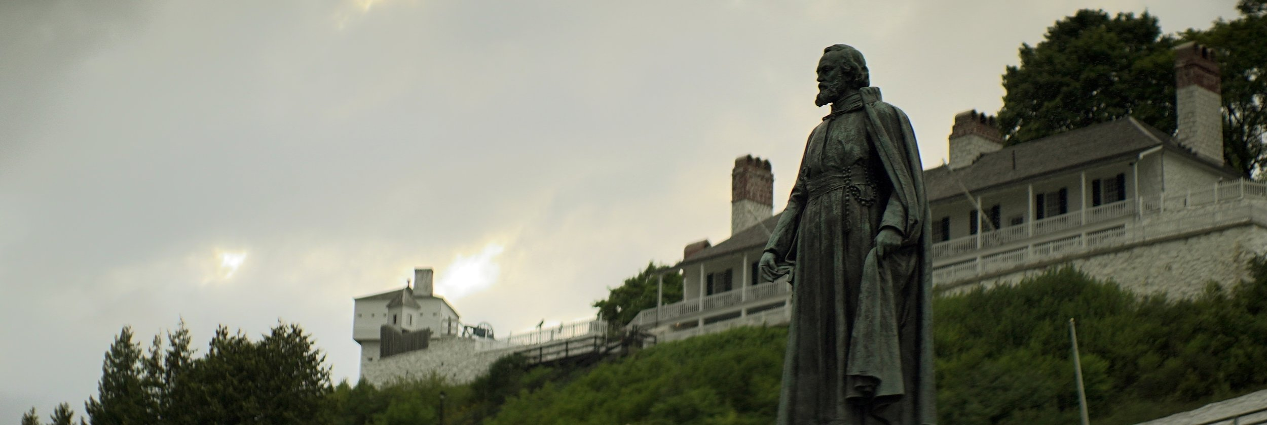 Lomo 100mm anamorphic lens | Statue of Father Marquette in Marquette Park - Mackinac Island, MI - Photo by: Keith Nickoson