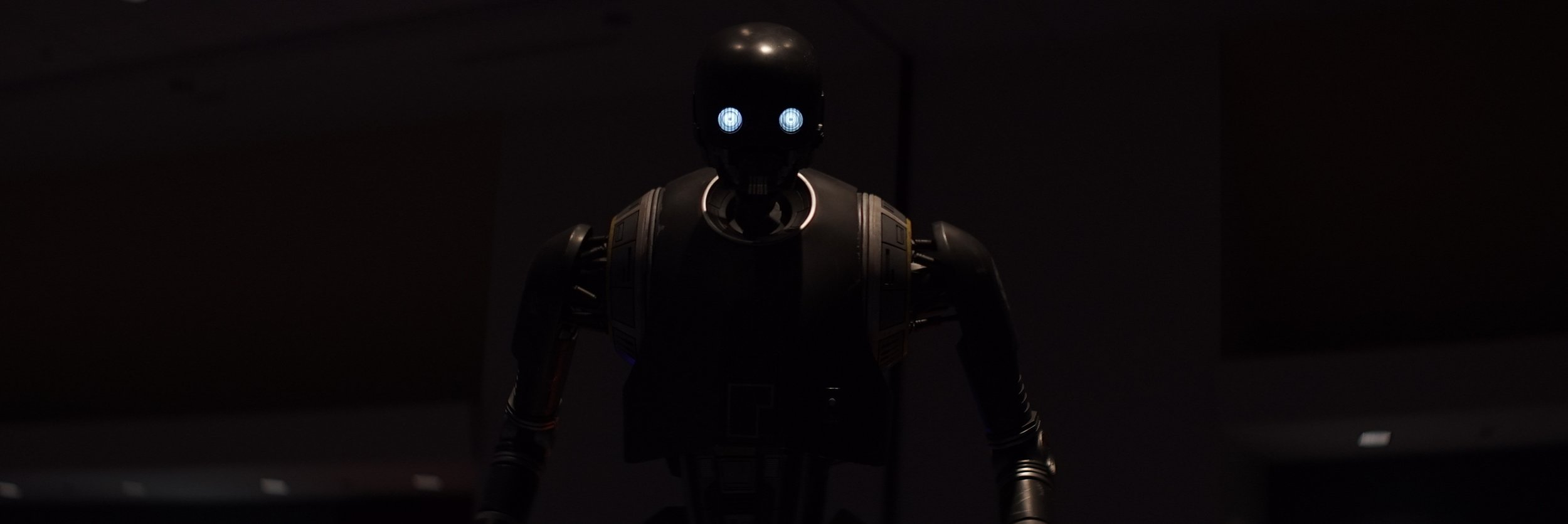Lomo 75mm Anamorphic Lens | Star Wars Celebration Chicago - SWCC | K-2SO in the Droid Builders room. I loved keeping this image very dark. - Photo by: Keith Nickoson