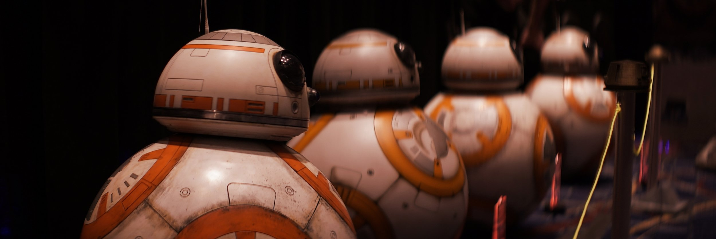 Lomo 75mm Anamorphic Lens | Star Wars Celebration Chicago - SWCC | A group of BB-8 droids stand in a line in the Droid Builders room. - Photo by: Keith Nickoson