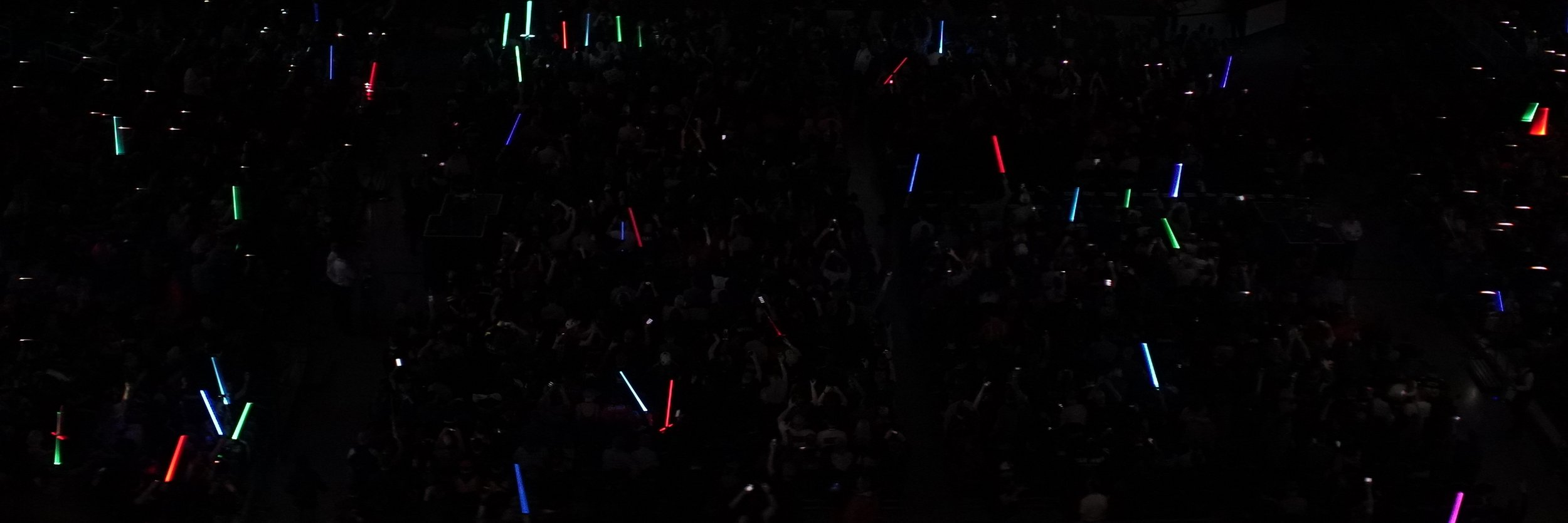 Lomo 75mm Anamorphic Lens | Star Wars Celebration Chicago - SWCC | A crowd filled with lightsabers for The Phantom Menace 20th Anniversary panel at the Wintrust Arena, McCormick Place Chicago, IL - Photo by: Keith Nickoson