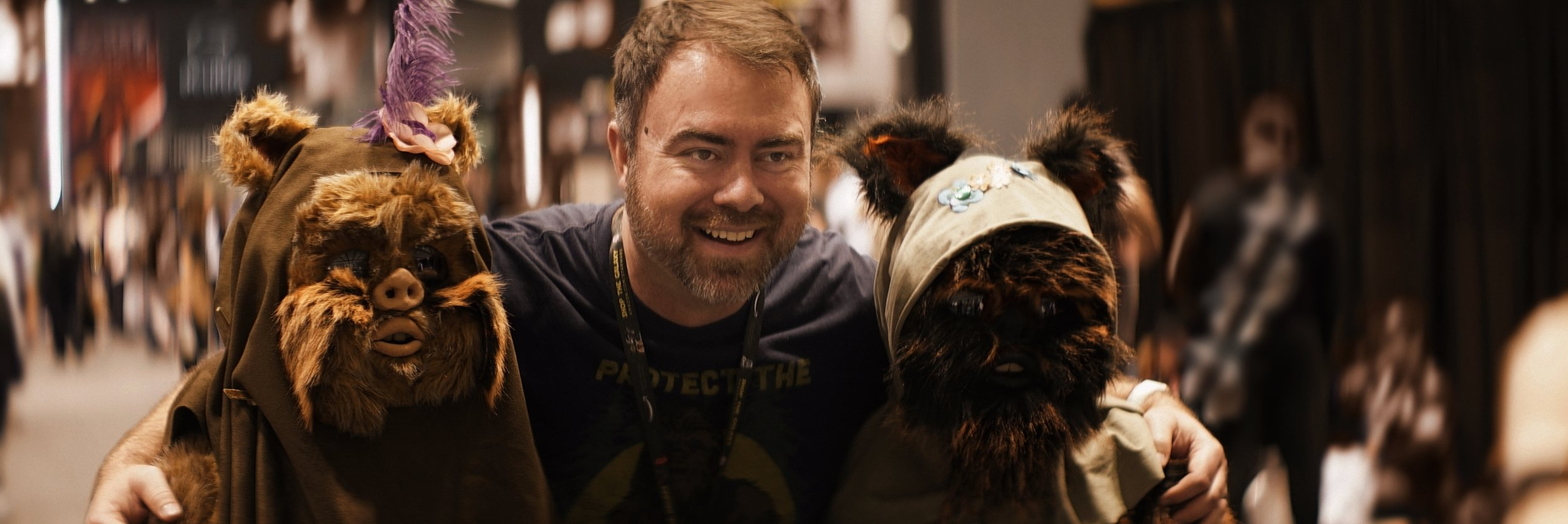 Lomo 75mm Anamorphic Lens | Star Wars Celebration Chicago - SWCC | Alan Brown, the host of Star Wars 20, and creator of Forcechella, poses with some Ewoks. Olivia and I became fast friends with Alan and his co-host Jon Chiado when we bonded over Reylo. You can find their Star Wars content here:    Star Wars 20 YouTube    and on the web:    starwars20.net
