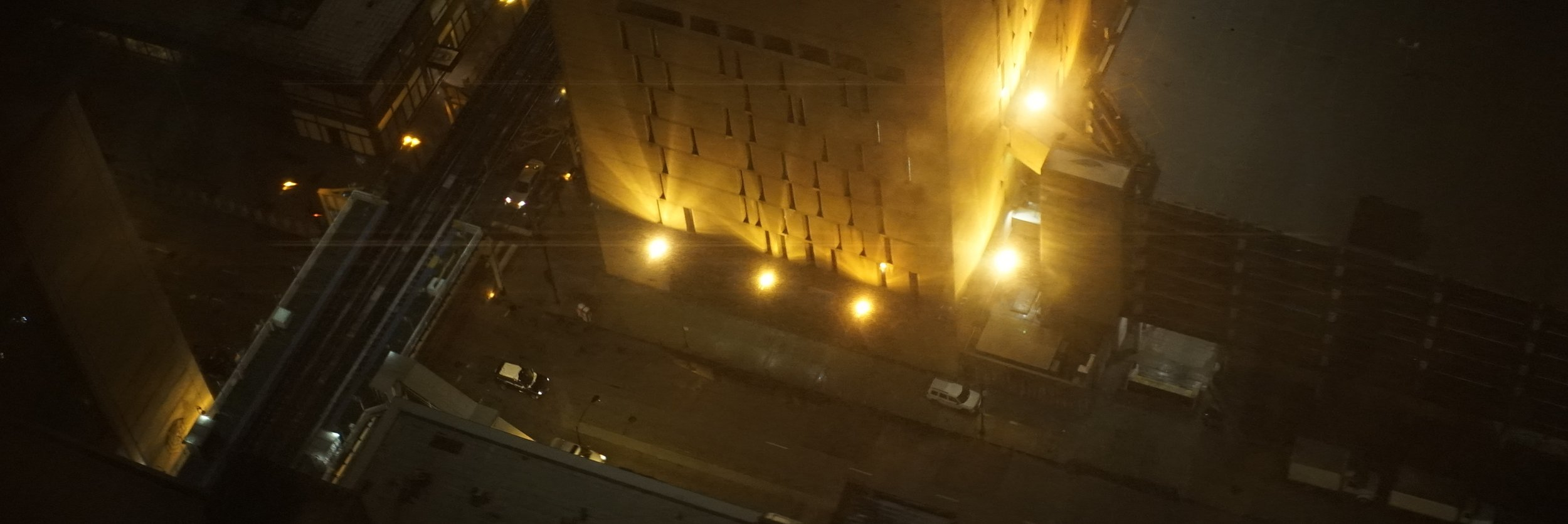 Lomo 75mm Anamorphic Lens | Flares from the base of a correctional facility in downtown Chicago, IL. - Photo by: Keith Nickoson