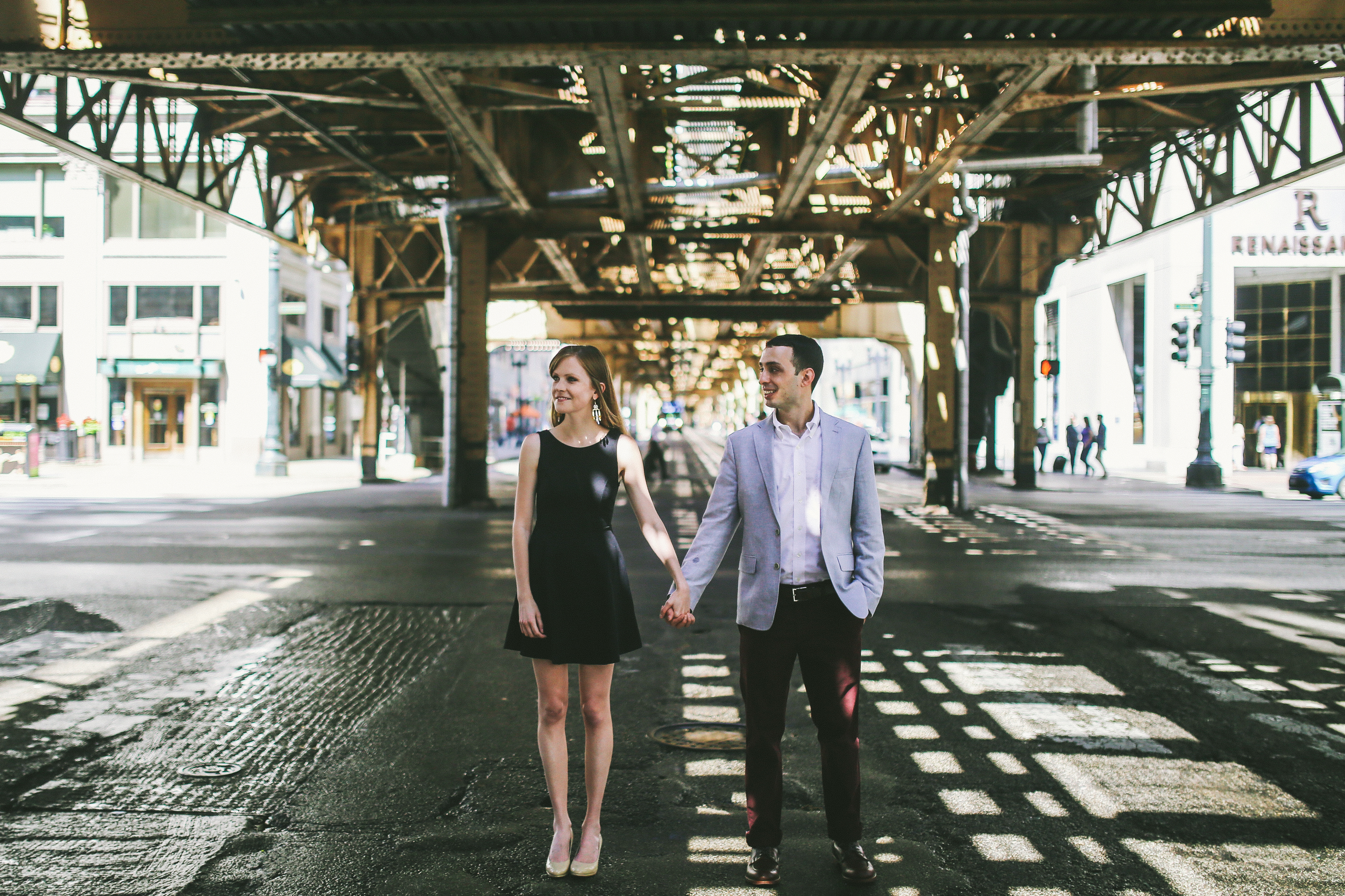 Chicago middle of the road, under the train engagement adventure photographer
