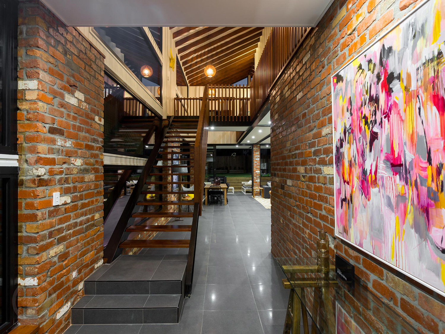 """This contemporary abstract painting """"Pump up the Jam"""" from my 80s themed exhibition in 2014 makes a bold statement against the 100 year old recycled bricks in this home built by my husband Todd of  ZieglerBuild  and styled by  Coco Republic ."""