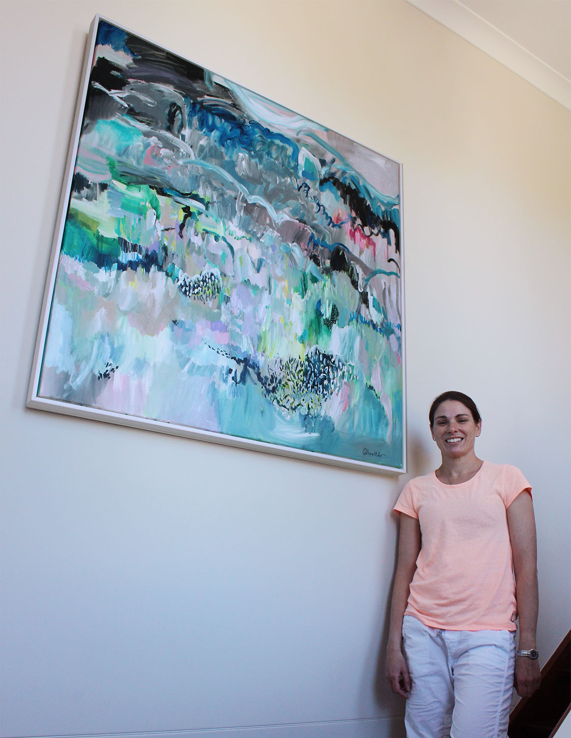 "Tahnee with her painting ""Moments in Spontaneum"""