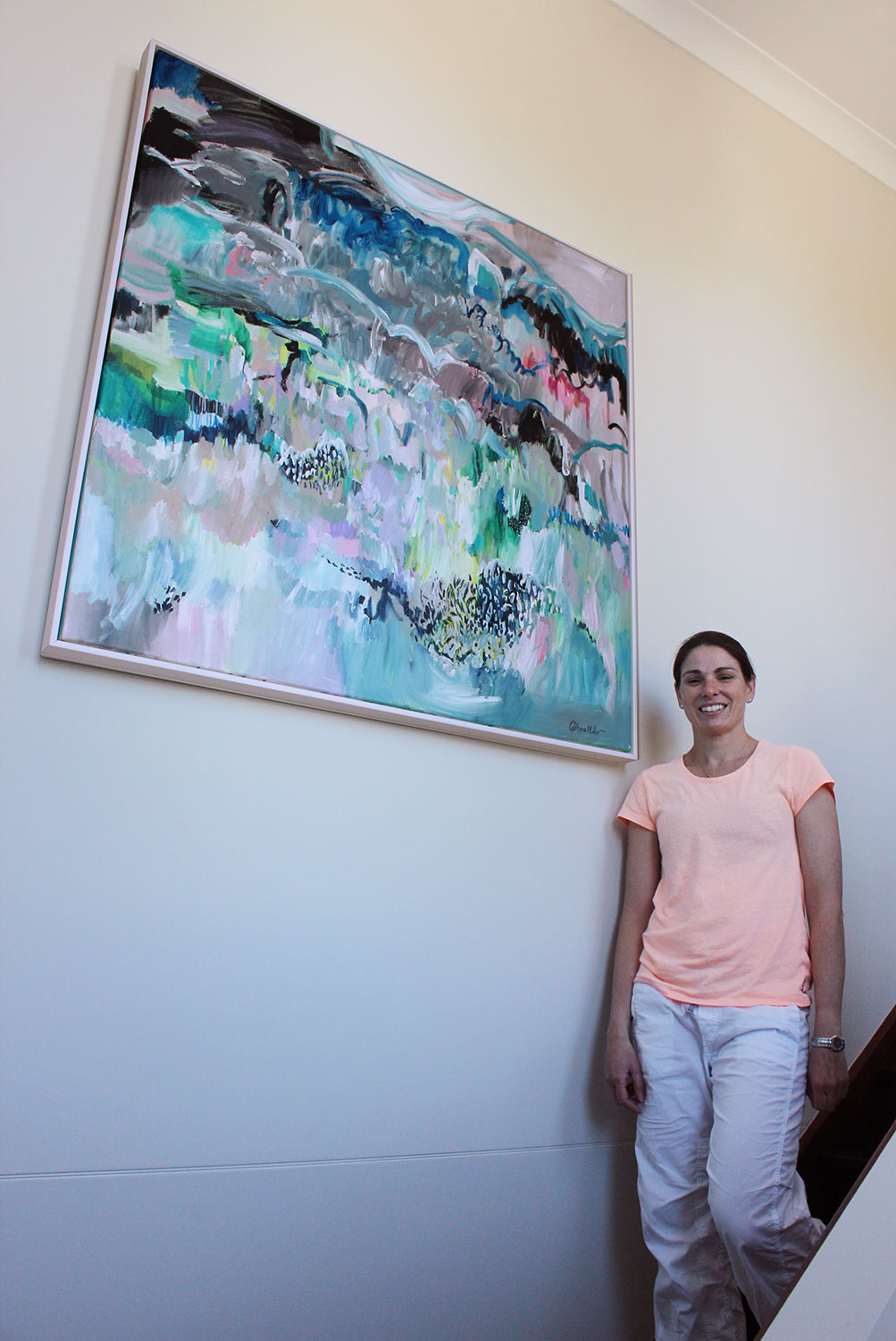 """Tahnee in her home stairwell where the title piece from my 2015 solo show """"Moments in Spontaneum"""" hangs"""