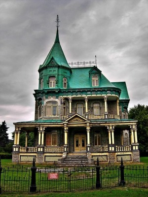 Located in Quebec has a distinctive copper roof that has weathered over time.