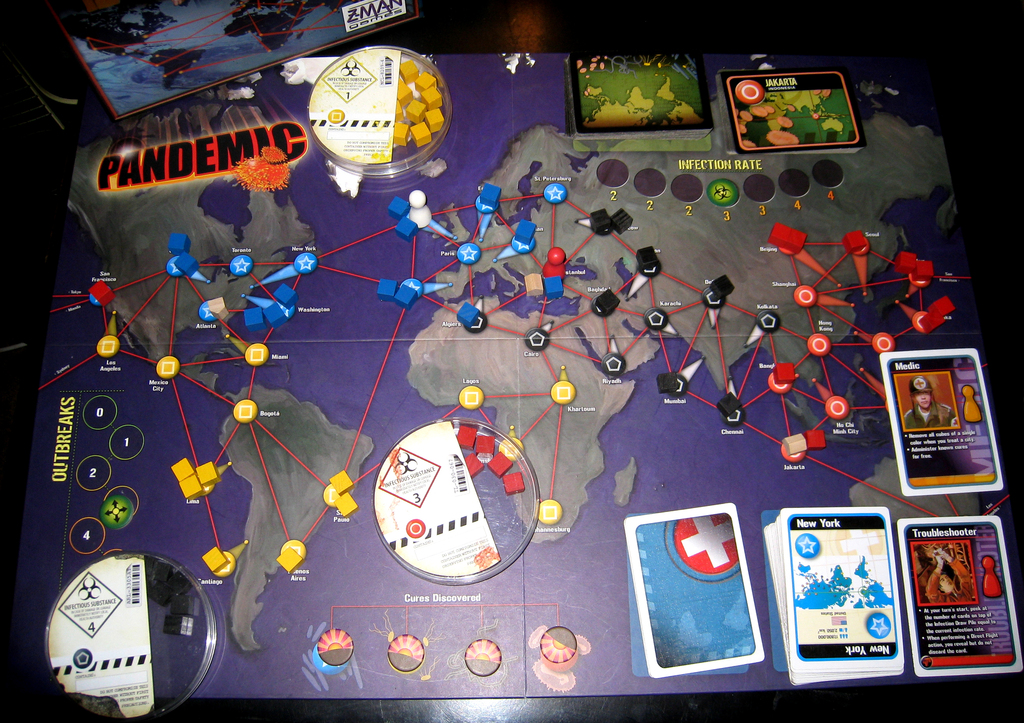 Imagine a (maybe less hectic)  Pandemic  with the bio-terrorist variant, but the players are grudgingly working together to combat  social  illnesses, while also working against each other to rule the world. Oh, and the bio-terrorist is the AI government player. ( Mark Lim )