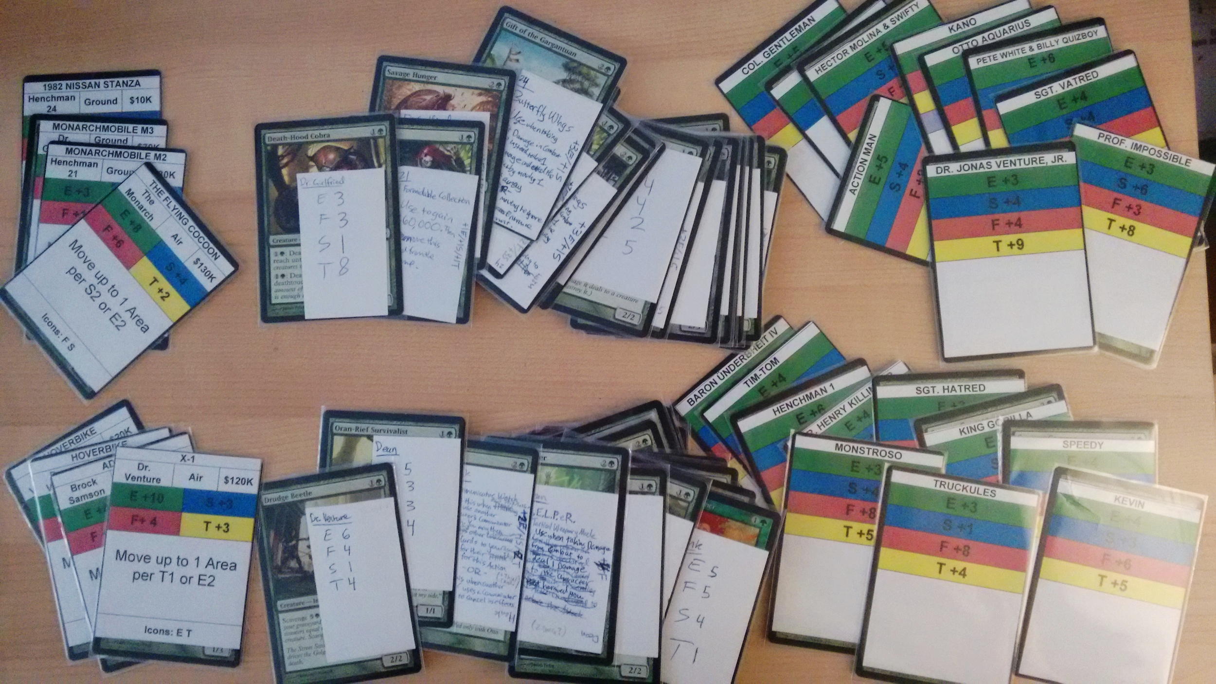 Old prototyping of Character Skill Cards, Item Cards, Vehicle Cards, and Ally Cards. (Yes, the piles of Ally cards are in the wrong rows, what of it?)