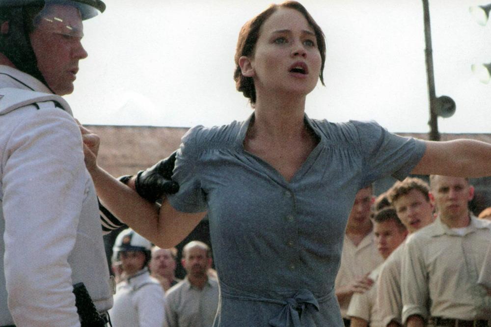 "Katniss ""volunteers"" as tribute. The Hunger Games (2012)"