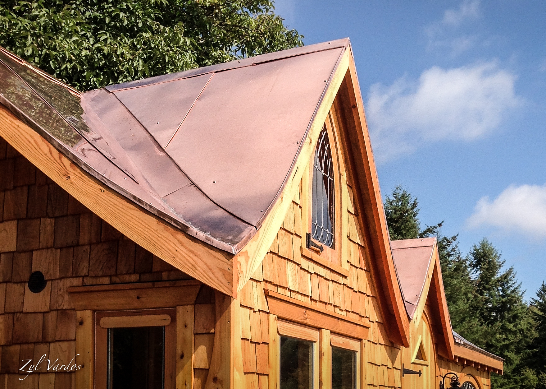 Hand-fabricated copper and steel roofing - We achieve unique and weatherly roof designs by hand-fabricating them from raw materials. We have 25 years experience in custom residential roof systems.