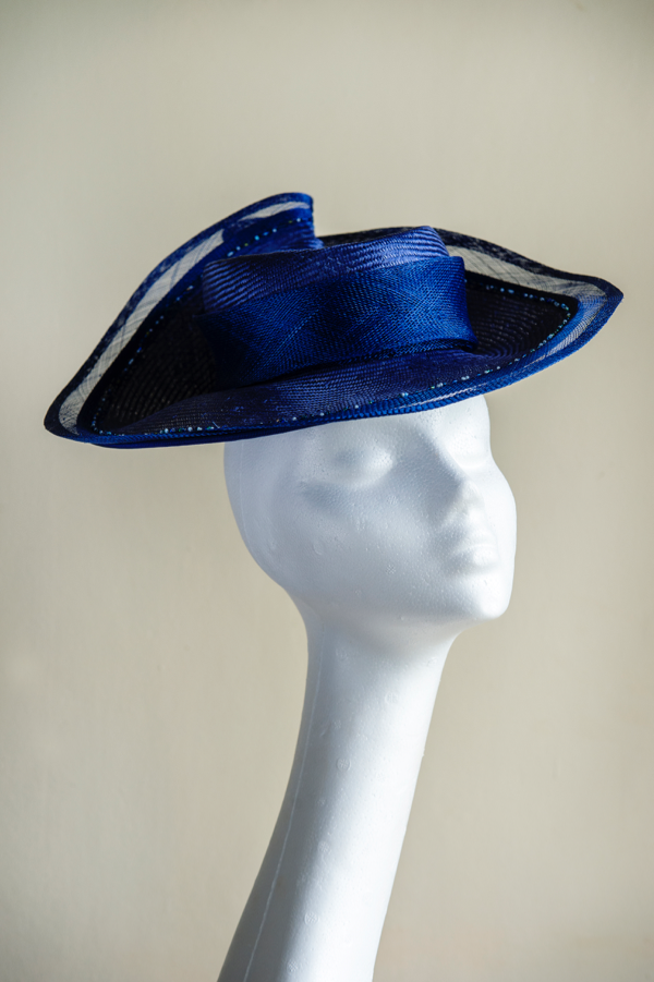 Royal blue percher hat *Sold*   with a hand beaded bind. Striking and elegant. This hat is secured to the head with an elastic.