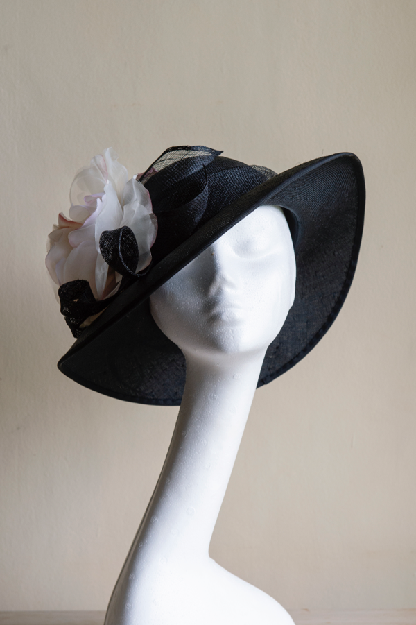 Classic picture book straw hat   With sinamay coils and a handmade silk and organdy rose. This hat is made to a standard head fit of 22.5""